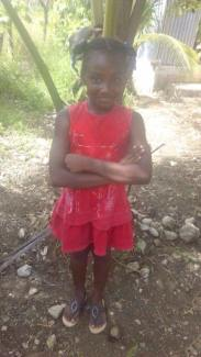 Little Jean Louis Cardona is 9 and in grade 3. She lives with her mom. She would love to go to school.