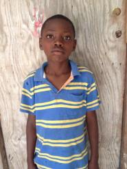 Shinatti Motisse is 11 and is in grade 4. His parents are unable to send him to school.